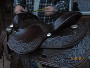 Angle close up view of brown leather horse saddle